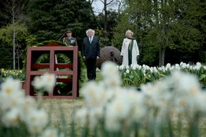 President Michael D. Higgins and his wife Sabina lay a wreath