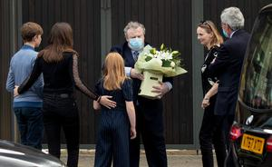 Pat's wife Frances and the couple's children receive a bouquet of flowers