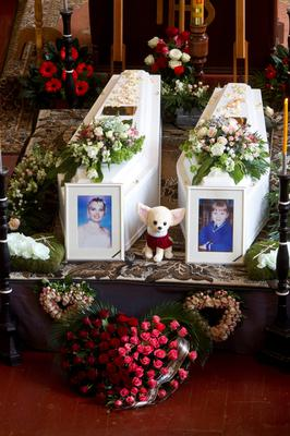 The remains of Jolanta Lubiene and her daughter Enrika at the foot of the alter at their funeral mass in Lithuania