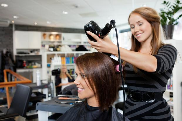 Hair salon owners are pushing to reopen by end of the month. Stock image