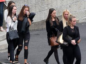 Friends grieve at the funeral of Olivia Burke, one of the victims of the Berkeley balcony tragedy, at the Church of Our Lady of Perpetual Succour in Foxrock in Dublin