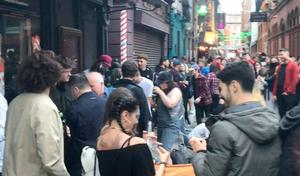 Crowds congregate on the street in the city centre