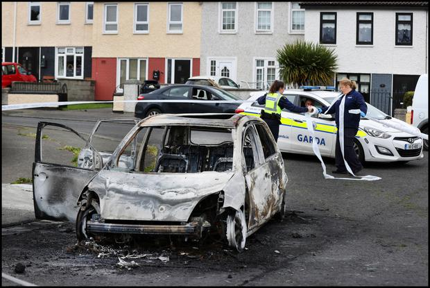 A burnt out car used by the gunman