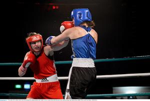 Ireland's Katie Taylor, Bray Boxing, left, exchanges punches with Caroline Verveyre, Canada. Road to Rio with Katie Taylor and Bray Boxing Club, Mansion House, Dublin