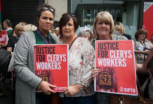 16/06/2015 Clerys Staff (L to R) Emma Kelly from Ratoath, Carol Meade from Cork st & Louise Murray from Blanchardstown during a protest outside Clerys on O'Connell Street, Dublin in support of workers who lost their jobs when the company went into liquidat