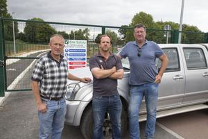 Building contractors Lar Conway, Brian O'Carroll and John Foran stand outside the entrance to two schools in Bray