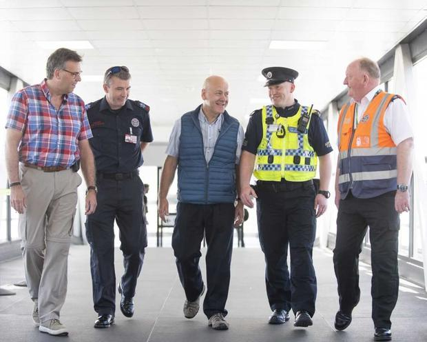 From left: Alastair Hamilton, paramedic Brendan Conway, David McMillan and Sgt Keith Pedreschi at the airport