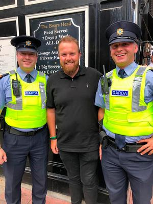 Shane Lowry on Capel Street yesterday with Sgt Gillolley and Insp Cullen