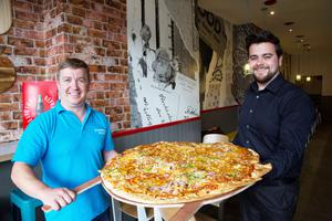 Mark McConville attempts to eat Ireland's largest pizza