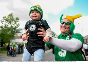 Republic of Ireland supporters Gareth Crawley with his 11 month old son Kai, from Dundalk, Co. Louth, on their way to the game. Three International Friendly, Republic of Ireland v England