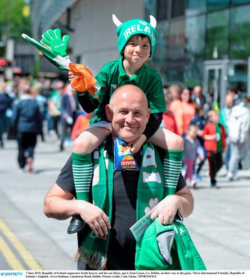 Republic of Ireland supporters Keith Keavey and his son Dáire, age 6, from Lucan, Co. Dublin, on their way to the game.