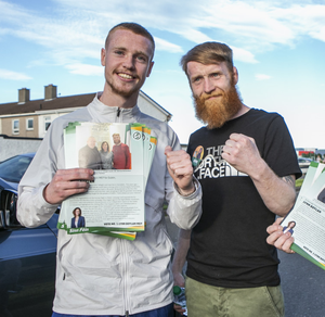 Paddy Holohan chatting with Liverpool FC player Glen  McAuley in Jobstown