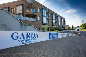 Gardai seal off the scene in Clonee, Co Meath after a man was chased and shot