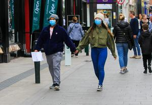People wear medical masks in Dublin city centre yesterday