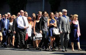 Family and friends walk with the remains of Berkeley tragedy victim Eoghan Culligan arrive for his funeral at The Church of the Annunciation, Rathfarnham, Dublin. Photo: Gareth Chaney Collins