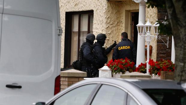 Gardai and members of the Armed Support Unit carried out a raid at a house in Cabra, north Dublin, as they hunted a man suspected of being involved in organised crime
