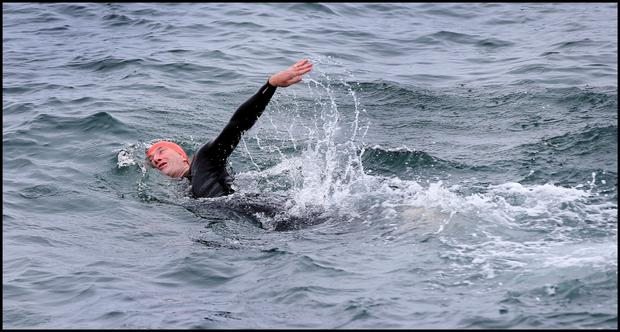 Some swimmers including Christopher Grey from Dun Laoghaire ignore the Do Not Swim signs posted at The Forty Foot
