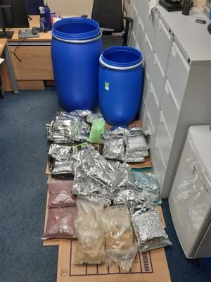 Two barrels were located containing suspected ecstasy tablets packed in bags