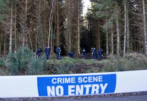 Gardai during a 2014 search of woodland for the remains of Fiona Pender