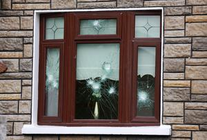 The damaged windows of the home of Michael Frazer