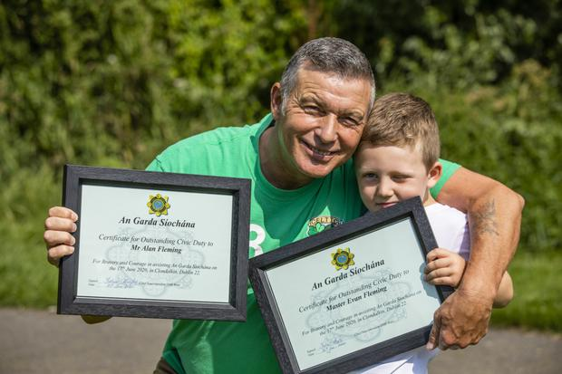 Evan Fleming and his grandad Alan Fleming who recieved award's from An Garda Siochana after he helped gardai rescue Ann Lam and her dog Millie