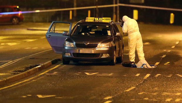 Gardai at the scene of the shooting at the Bridge of Peace