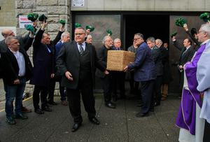 The coffin of Pat Laffan is carried from St Michael's Church, Dun Laoghaire