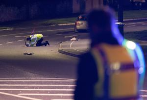 Gardai examine the scene where two women were hit and seriously injured by a car