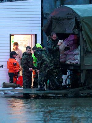 Members of the Army bail out water from shops in the Ballybofey area of Donegal