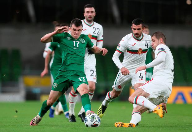 Bulgaria's Georgi Angelov tackles Ireland's Jason Knight during the Nations League match at the Aviva last Wednesday. The game was played with no fans and no large garda presence