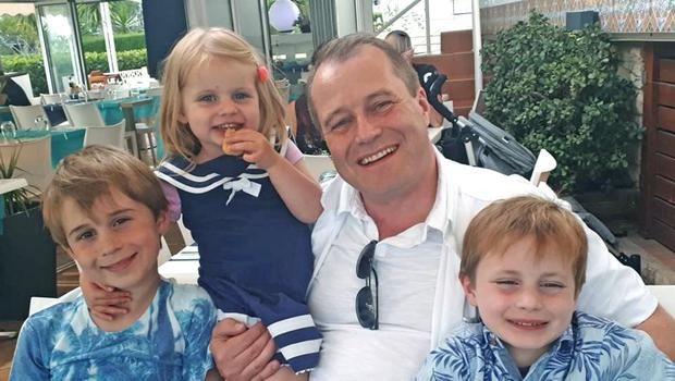 Andrew McGinley with his children Conor (9), Darragh (7) and Carla (3)