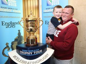 Ian Reid from Clondalkin with his son, Ben (4), with rugby's most prestigious prize, the Webb Ellis Cup, which was on a visit to Our Lady's Children's Hospital