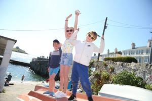 Ollie, Sam and Max Mitchell enjoy the fine bank holiday Monday weather with a break from home at Coliemore Harbour, Dalkey. Photo: Stephen Collins/Collins Photos