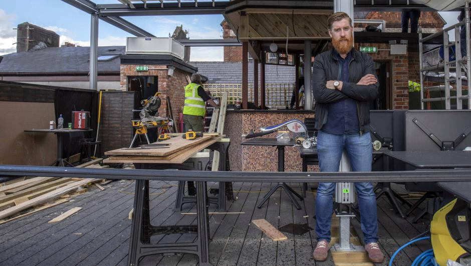 Michael 'Sully' O'Sullivan oversees work on the new roof area of Clancy's bar in Cork city.