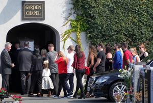 Sean's coffin is carried into the chapel at Mount Jerome Crematorium