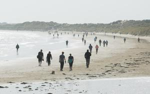 People observe personal distancing on Portmarnock beach yesterday