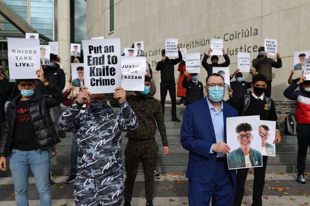 Family and friends of teenager Azzam Raguragui, who was stabbed to death, demand knife crime reform in a protest outside the Criminal Courts of Justice