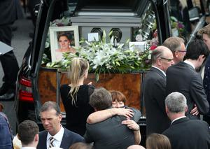 Olivia Burke's mother, Paula is consoled at the funeral of Olivia Burke, one of the victims of the Berkeley balcony tragedy at the Church of Our Lady of Perpetual Succour in Foxrock in Dublin
