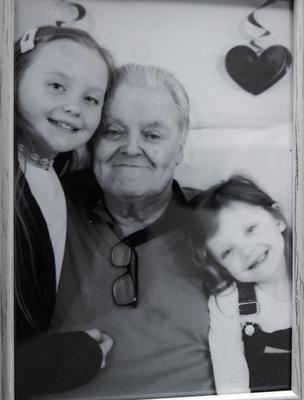 Ray with his granddaughters Megan and Annie