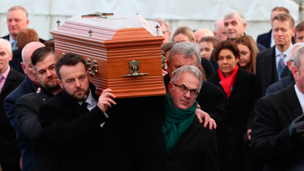 Colum Eastwood (left) and Alex Attwood of the SDLP carry the coffin of Seamus Mallon