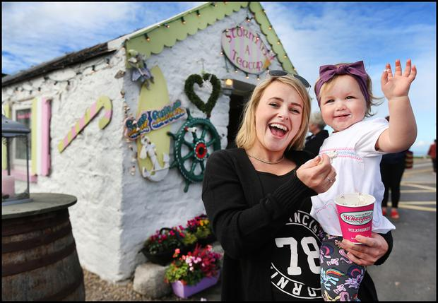 Emma Hodgins celebrates Skerries' win with her god daughter Sadie Mae Butler Picture: Steve Humphreys