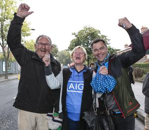 Seamus Cassidy with Claire Heffernan Cassidy and Declan Brennan, Drumcondra at the All-Ireland Ladies Final yesterday