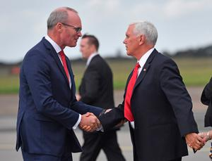 Simon Coveney greets US Vice President Mike Pence at Shannon Airport