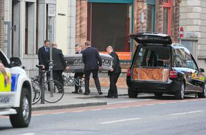 The remains of Olivia Burke, one of the victims of last week's balcony collapse in Berkeley in which six students died arrives at the Fanagans Funeral home on Aungier Street, Dublin