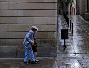 An elderly Spanish couple out walking with face masks on