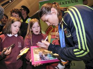 Katie Taylor pictured with Naoise (10) and Aoidhin(8) MacIonnraic from Dublin and at Dublin Airport this evening after arriving home after winning her fifth World Title in Korea.. Picture Colin Keegan, Collins Dublin.