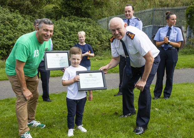Garda Brendan Crawford, Garda Ciaran Murray and Garda Ciara Galvin from Clondalkin Garda station who recieved award's of commendation with distinction for excellent Police work after rescuing Ann Lam and her dog Millie from the river Camac in Dublin.
