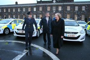 Launch: Garda commissioner Noirin O Sullivan, Taoiseach Enda Kenny and Minister for Justice Frances Fitzgerald with some of the new Garda  cars  in the main square at Garda HQ