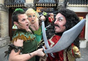 Peter Pan [ Johnny Ward]  and Tinkerbell [ Sarah  Bradley ]  clash with  Captain Hook [ Nicholas Grennell
