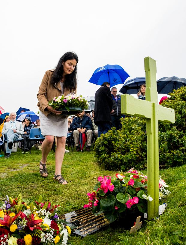 Lisa McKean lays a wreath for her brother Paul Maxwell. Photo: Liam McBurney/PA Wire